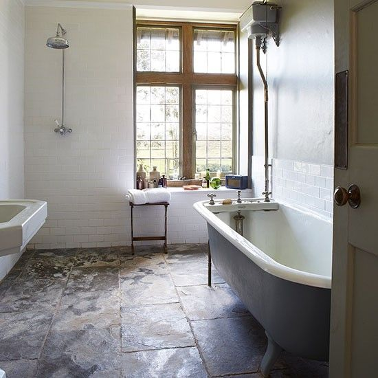 Reclaimed pieces such as the elegant freestanding bath emphasise the period feel in the bathroom, while the stunning slate floor continues the country theme. Read more at http://www.housetohome.co.uk/house-tour/picture/step-inside-this-period-manor-house-in-somerset#7zK1C0Qq51R5MtKE.99