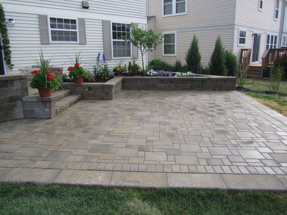 Patio Step Down And Retaining Wall For The Home