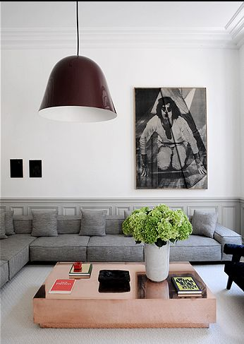 copper coffee table, grey sofa, huge pendant lamp. Decor. Living Room. Portrait. Art. Home. Design.