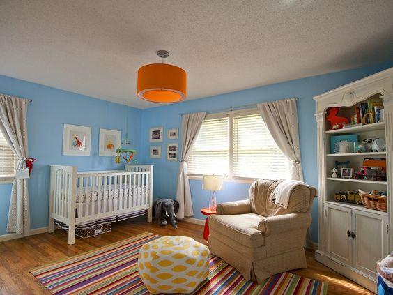 Colorful gender neutral nursery - love the orange drum light!
