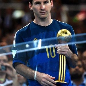 Lionel Messi of Argentina receives the Golden Ball trophy