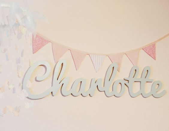 Custom Wooden Name from @The Spotted Zebras - we love the whimsical touch this cursive name art adds to the nursery or kids room!