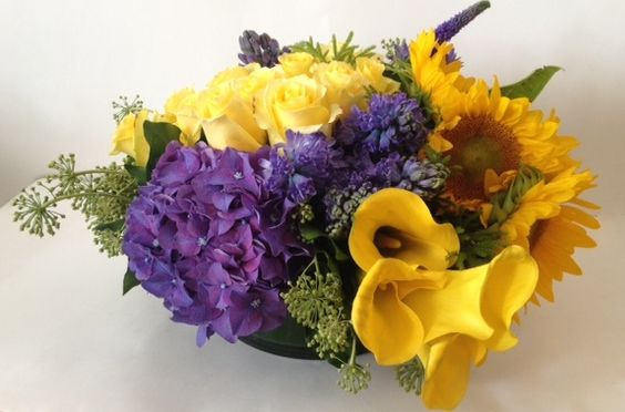 Large sunflowers and hydrangea centerpiece purple
