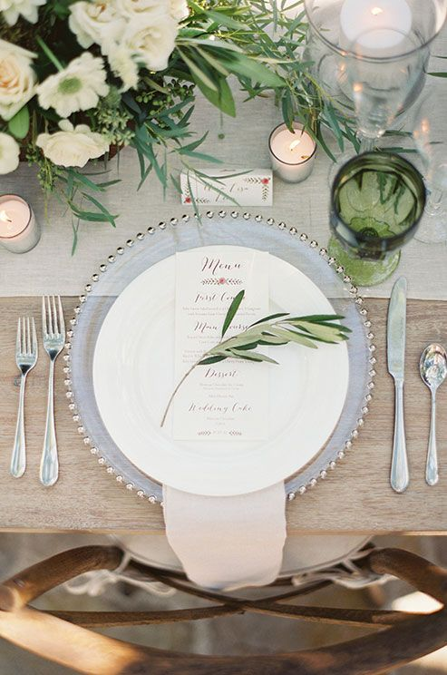 Each guest's place setting is punctuated with a dinner menu printed in rose colored ink.