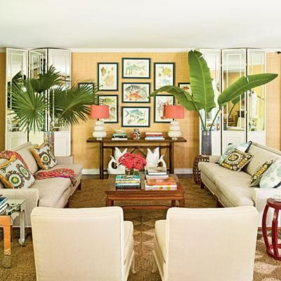 a mix of retro furniture vintage decorations and tropical accents give this room its