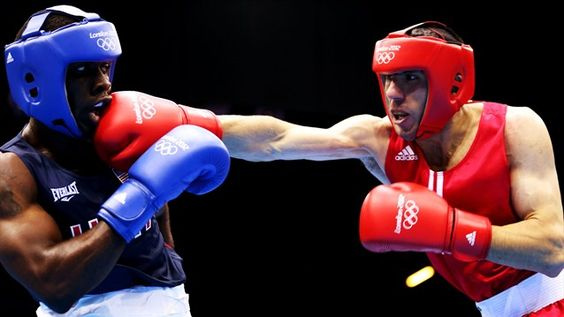 Armenian Hakobyan throws a right during bout with USA boxer Gausha  Andranik -Hakobyan of Armenia throws a rightagainst Terrell Gausha of USA during their men's Middle Weight (75kg) bout on Day 1 of the London 2012 Olympic Games at ExCeL. Gausha ended up winning the bout in the third round.