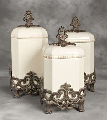 cream and iron canisters