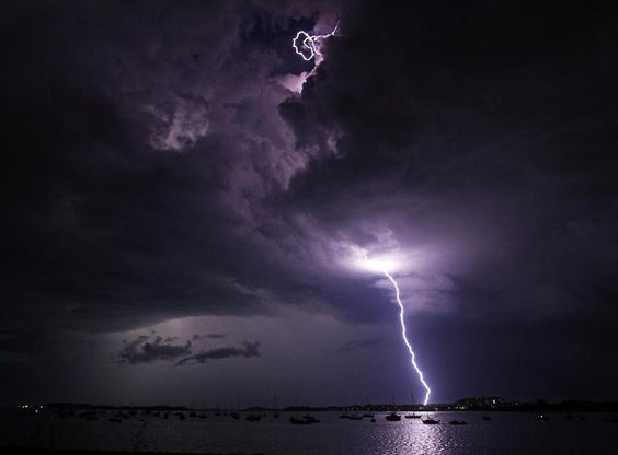 A vivd lightning storm over Dorchester Harbor 7/24/12 #poisonedweather #climate Jim Davis/Boston Globe