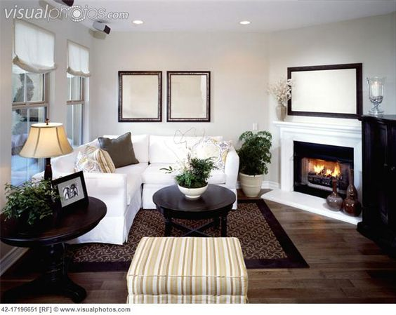 Living room layouts living rooms and fireplaces on pinterest - What to put in corner of living room ...