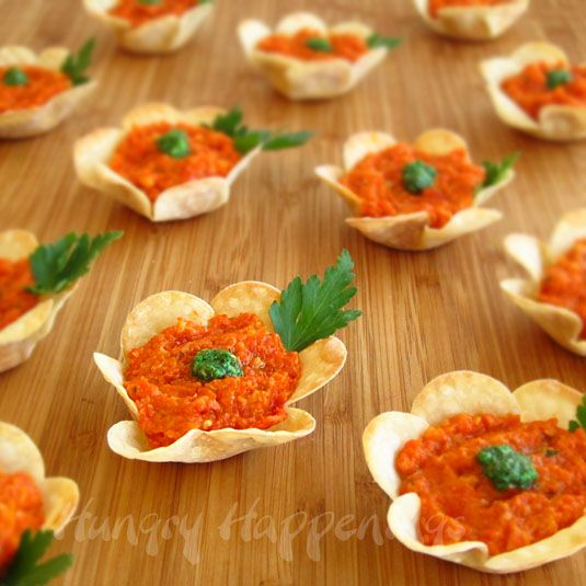 Great idea for a party // edible cup with goat cheese and red pepper pesto