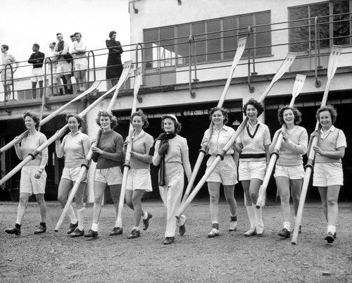 March 11, 1950: Wielding oars that resembled back scratchers for...