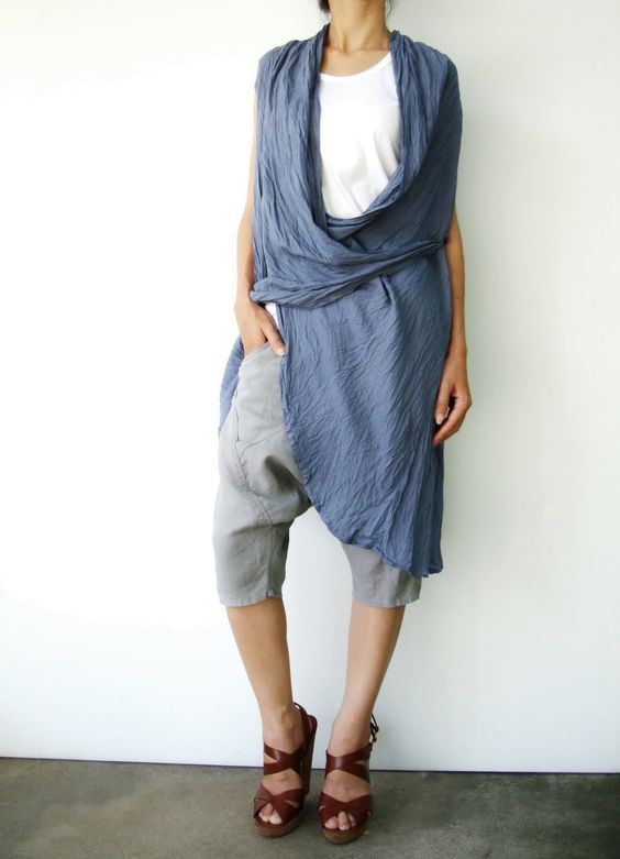 bluish grey tunic top.