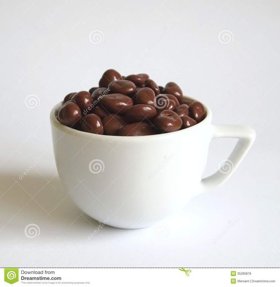 Chocolate balls in a white cup