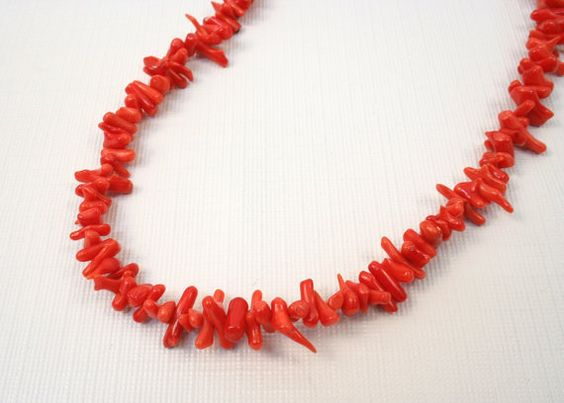 A vibrant red coral necklace with natural coral branches https://www.etsy.com/listing/106121555/coral-necklace-bright-red-natural-beaded