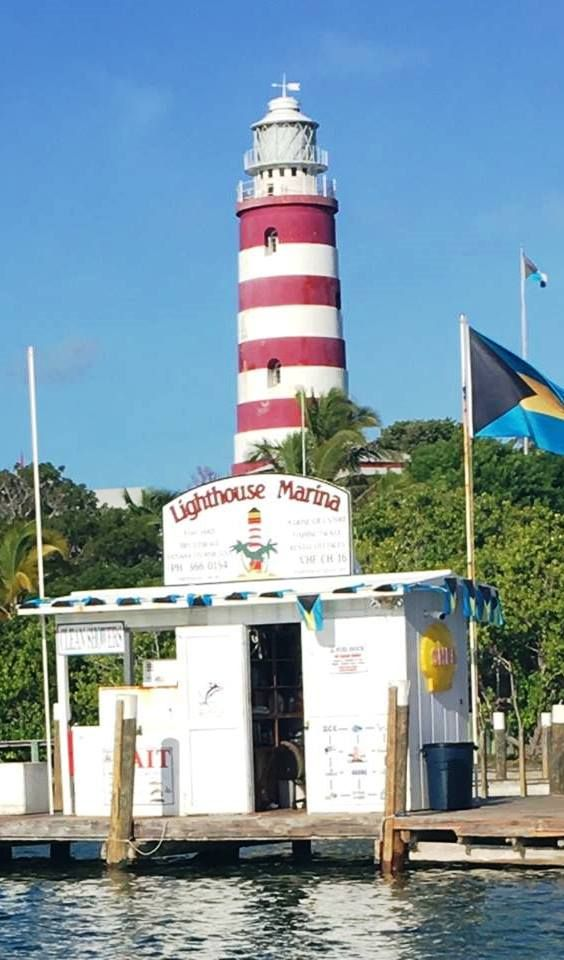 Lighthouse Marina At The Base Of The Historic Elbow Reef Light House In Picturesque Hope Town Harbour Abaco Lighthouse Lighthouse Inspiration Reef Lighting