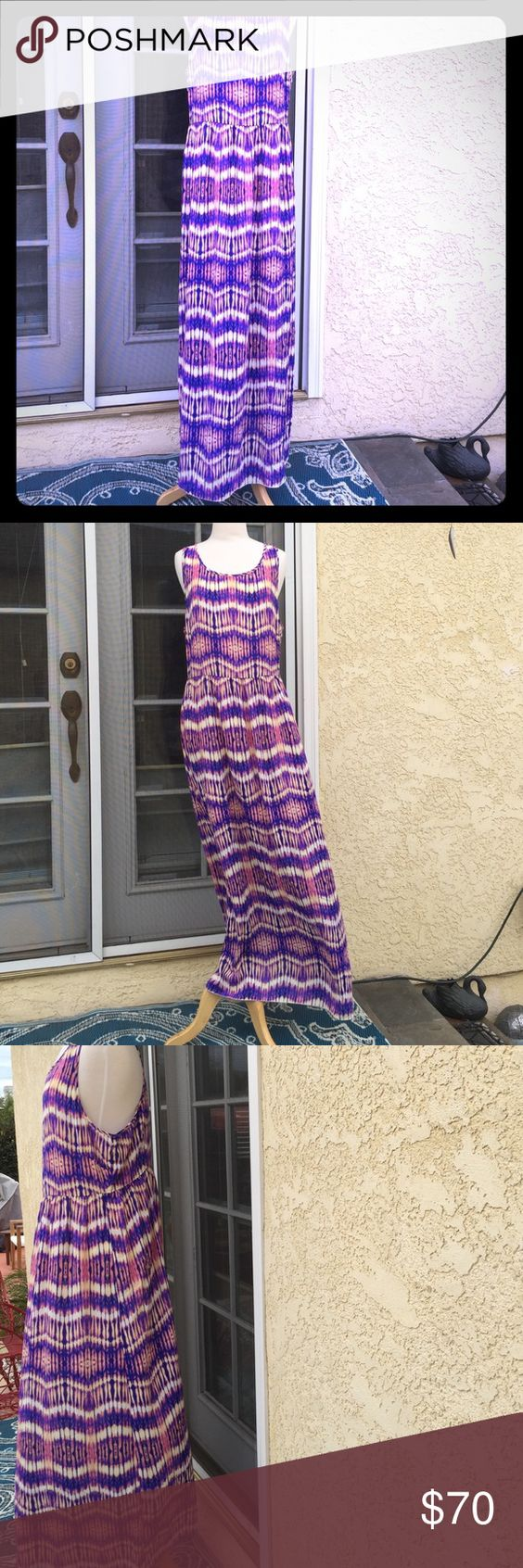 Neumann Marcus dress Stunning and flowing maxi dress with back zipper. Electric pattern of colors, Purple,blue, white,pink,and orange, half lining slip,100%poly. Worn once still new Neiman Marcus Dresses Maxi