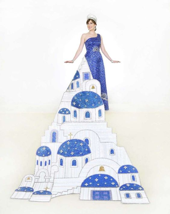 Marguerite Marcella Mannix, Duchess of Iconic Landscapes. The train depicts a hillside painted in white with blue domes to keep away evil. Bugle beads and other stones give the hillside a 3D effect and texture. The gown's skirt features a row of brooches made of semiprecious stones and the dress is beaded in two shades of blue bugle beads with silver crystals. She is the daughter of Mrs. John Kevin Mannix. Photo: Courtesy Gary Stanko / Billo Smith Photography: