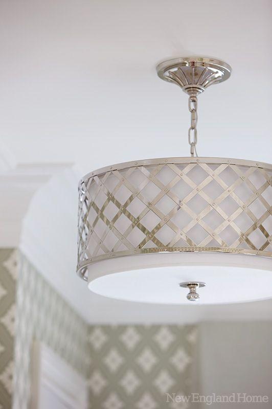 A modern drum-shade ceiling light.
