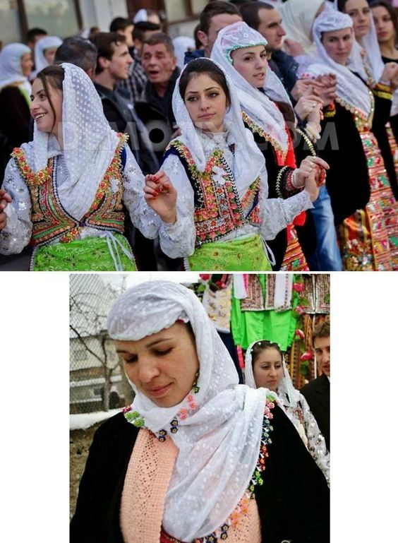 Women in traditional festive costumes, from the village of ...