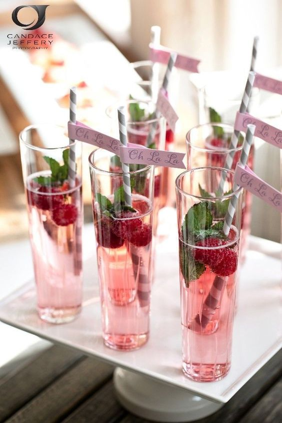 Unique signature wedding drinks add a personal flair to your wedding day. Dress them up with garnishes, striped straws, and personalized flags.