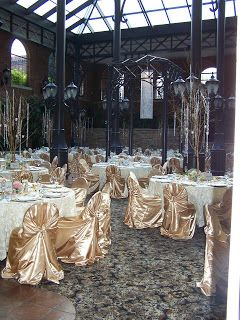 Elegant gold chair covers with white satin pintuck linens