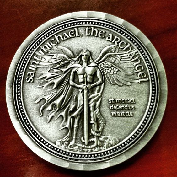 A Coin Featuring Saint Michael The Patron Saint Of Police