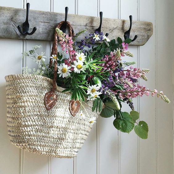 ___Hanging basket full of flowers adds a pretty touch to this wall.