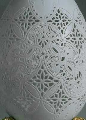 carved ostrich egg - looks like lace / whitework embroidery / cutwork...