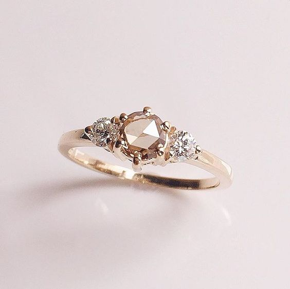 I love this ring!! Rose cut champagne diamonds are so in right now