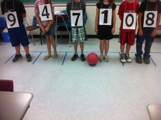 Human Place Value - love the ball as the decimal point. Try using this idea with converting in metric system. Have students wear numbers and another student moving decimal point.