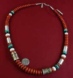 """mostly coral with various stones with sterling silver & gold filled drums, Navajo made by the famous """"Tommy Singer"""""""