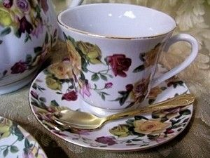 Dainty ANTIQUE ROSE pattern full size teacups and saucers. Sold as a set of 4 teacups and saucers, teacups hold approximately 8 ounces of fluid. Additional sets of 4 available. Fine china wonderfully perfect for tea parties! Tea Pot, dessert plates, two tier cookie tray and gold demi spoons also available separately. Designed and manufactured by us, The Queen's Treasures ®