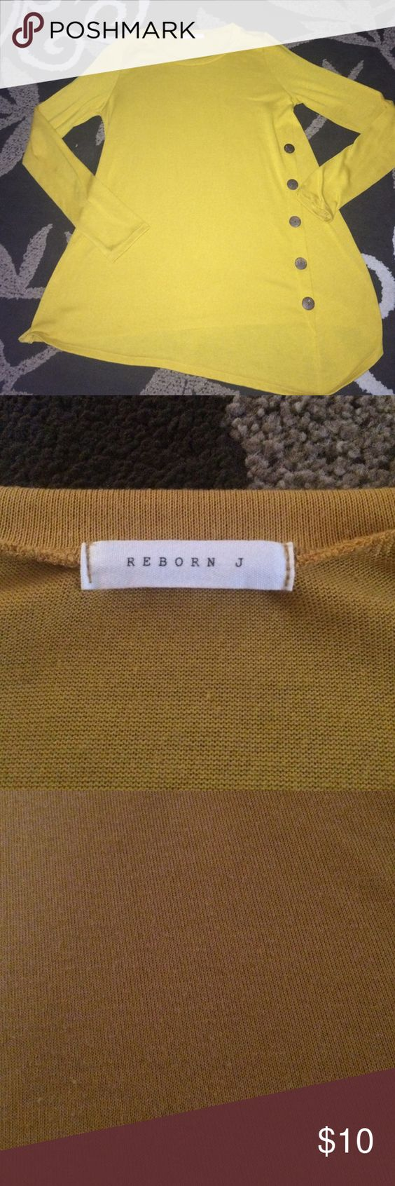 Mustard color tunic with buttons size L Gorgeous mustard colored tunic, brand is Reborn J and is a size L. Literally only worn once and looks great with leggings! Some very minor pilling, see pic 3, not really even noticeable, otherwise fanatic condition! Smoke free home, make me an offer and don't forget to bundle! Reborn J Tops Tunics