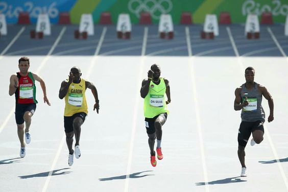 RIO DE JANEIRO, BRAZIL - AUGUST 13: Mohammed Abukhousa of Palestine, Holder da Silva of Guinea-Bissau, Wilfried Bingangoye of Gabon and Abdul Wahab Zahiri of Afghanistan competes in the Men's 100m Preliminary Round on Day 8 of the Rio 2016 Olympic Games at the Olympic Stadium on August 13, 2016 in Rio de Janeiro, Brazil. (Photo by Cameron Spencer/Getty Images)