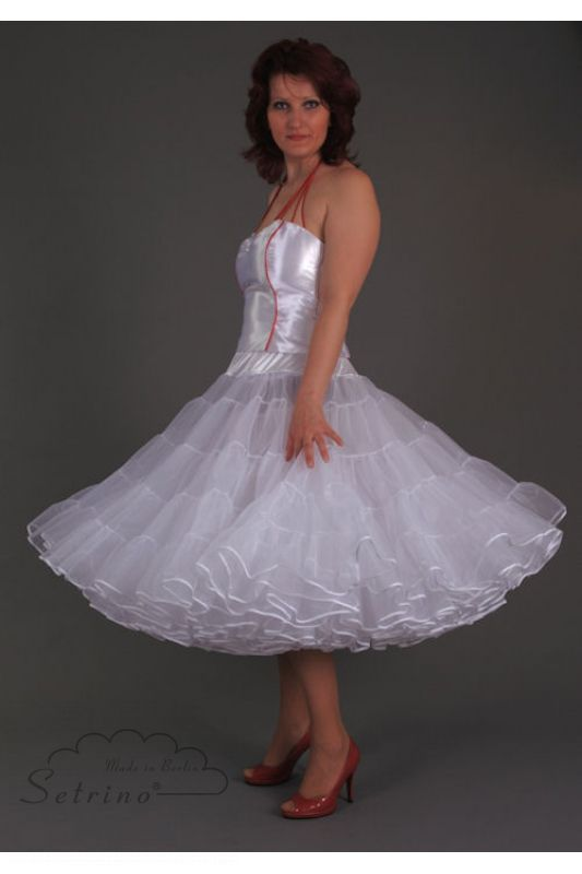 Julia does not look happy being forced to such a Frilly Feminine Petticoat dress