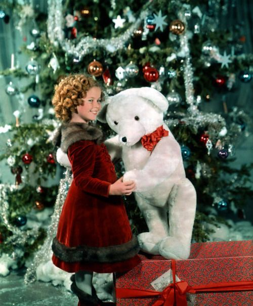 Shirley Temple with teddy bear - Christmas in Hollywood old photo.: