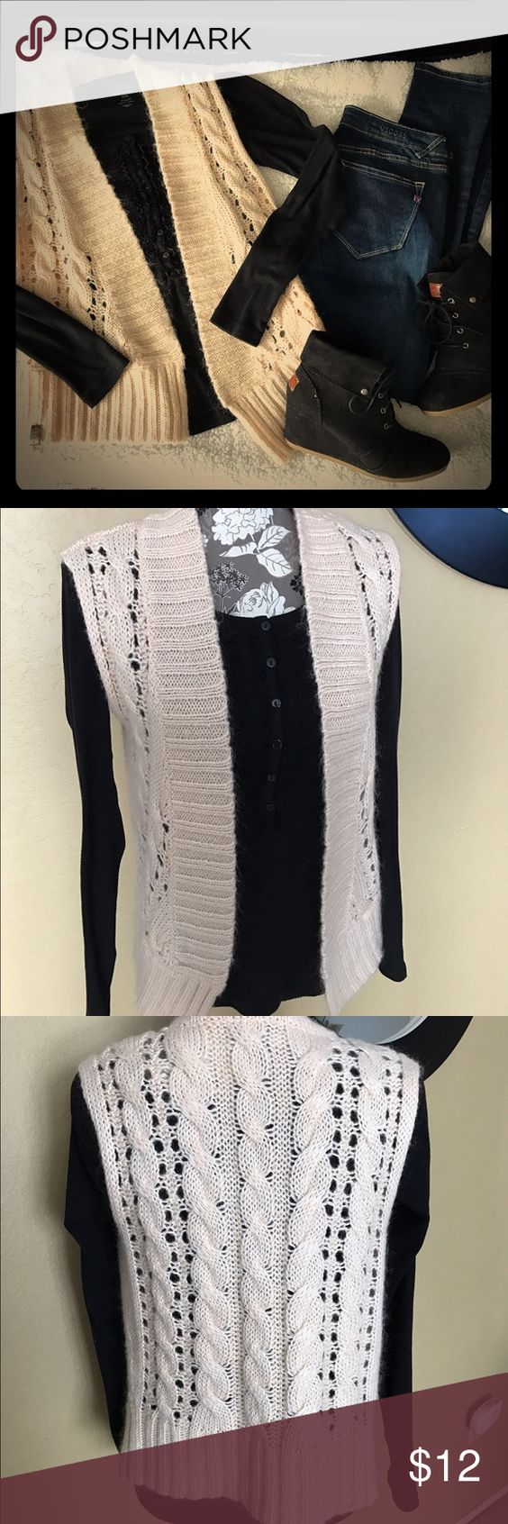 Light pink/cream sweater vest Very cute vest. It is a pale pink ...