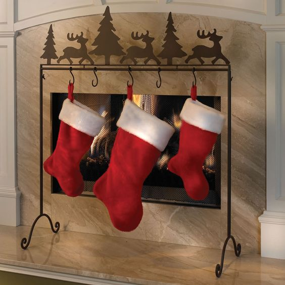 Carolers Displayed On A Mantle With Garland And Stockings: The Place Anywhere Stocking Holder: More Stable Than Hooks