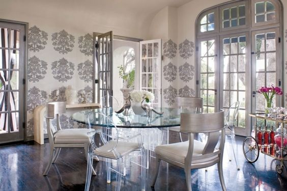 Graphic wallpaper makes the room feel modern, but recalls a more glamorous era