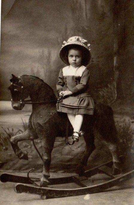 vintage side saddle pictures Little girl on rocking horse: