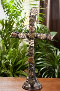 river rock and wire standing cross