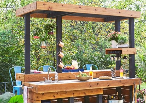 We Love This Outdoor Kitchen Center Complete With An All Weather Countertop A Seating C Outdoor Kitchen Countertops Diy Outdoor Kitchen Build Outdoor Kitchen