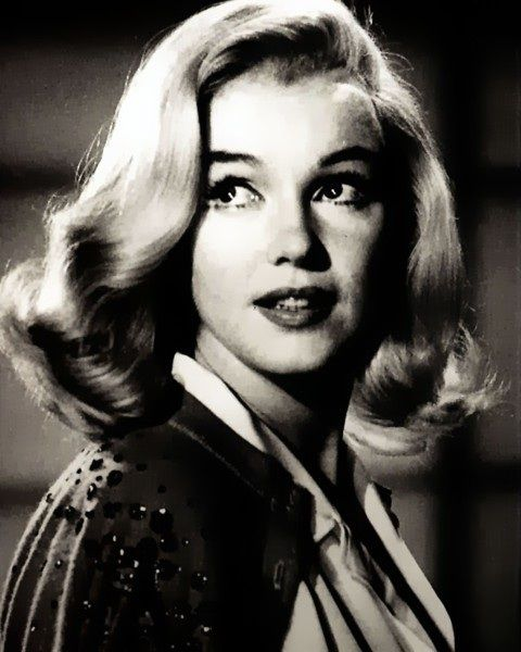 Marilyn Monroe with long hair.