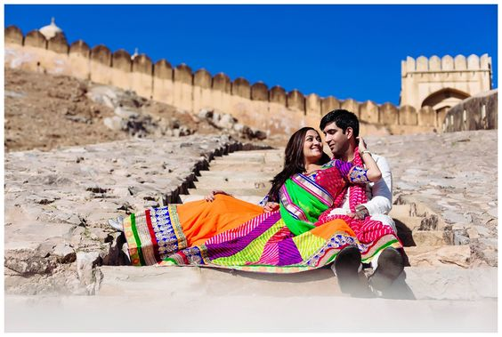 Pre wedding pictures at Amer Fort Jaipur India. Colorful lehenga adds to the beauty