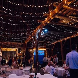 Dramatic #barnwedding lighting - see this wedding on RusticWeddingChic.com