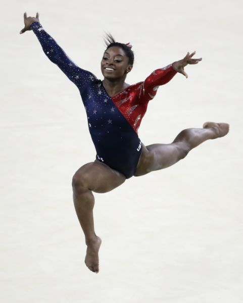 United States' Simone Biles performs on the floor during the artistic gymnastics women's qualification at the 2016 Summer Olympics in Rio de Janeiro, Brazil, Sunday, Aug. 7, 2016. (AP Photo/Dmitri Lovetsky)