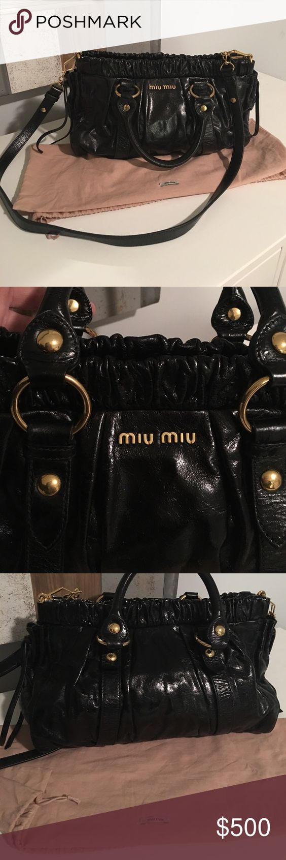 💯% Auth Miu Miu Black Gathered Tote Gold Hardware This is an authentic MIU MIU Vitello Lux Gathered Tote in Black.  This stylish tote is crafted of distressed black leather that is gathered at the top. The bag features rolled leather top handles with large polished brass links and studs, an optional leather shoulder strap and heavily gathered cinch-style top edge. This opens with a button snap to a black fabric interior with a zipper and patch pocket. This is a marvelous tote for everyday…