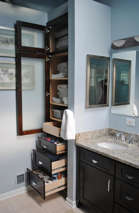 Maximum storage in a tight bathroom space via for Tight space bathroom designs
