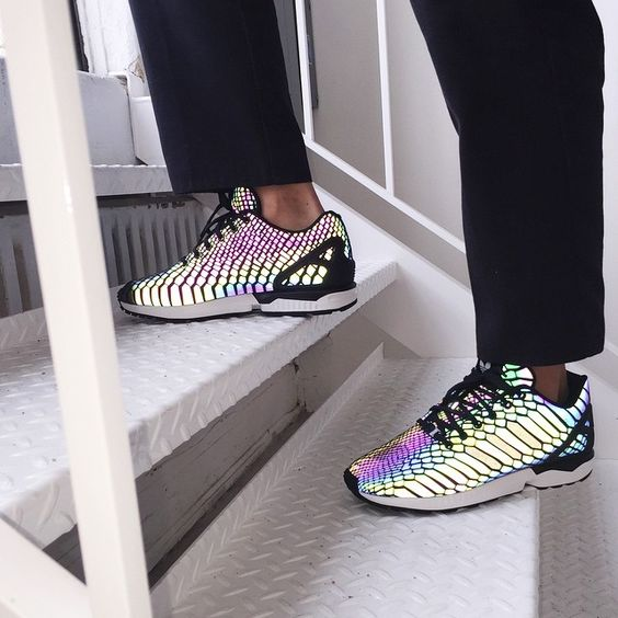 The new Adidas ZX Flux 'Reflective Snake' comes in a matte black with purple, green, and yellow undertones. With a flash of light, what you see is what you get.