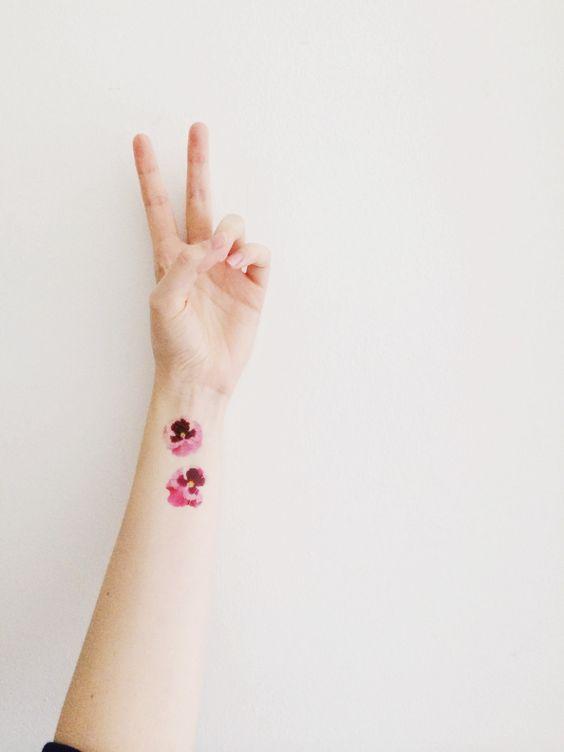 Pink mini pansy tattoos